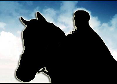 نفض الغبار من حوله وهو يجر حصانه العربي